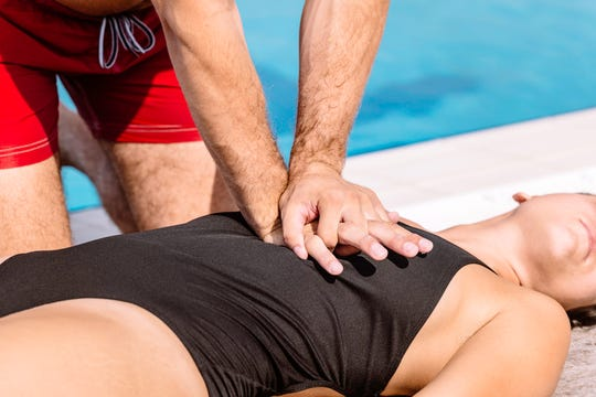Lifeguard rescue procedure - doing CPR compressions