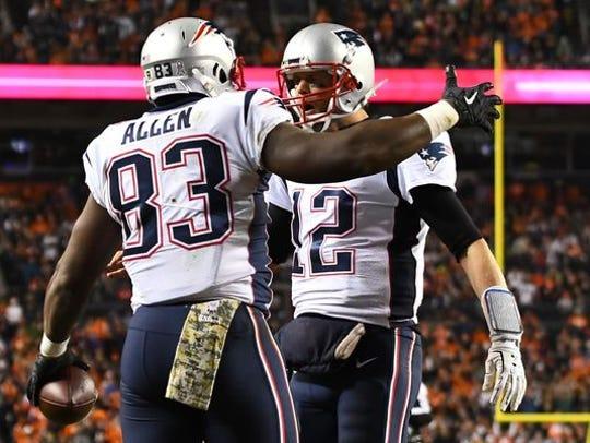 Former Clemson standout Dwayne Allen (83) celebrates with New England quarterback Tom Brady.