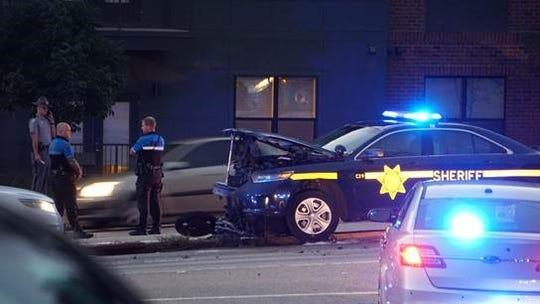 A crash involving a Greenville County deputy left a motorcyclist hospitalized.