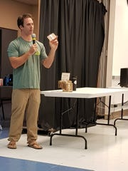 Entrepreneur Matthew Simpson holds up one of the environment-friendly wallets made and sold by Green Banana Paper. The 33-year-old former teacher founded his company in 2016 to provide job opportunities for young Kosraeans.