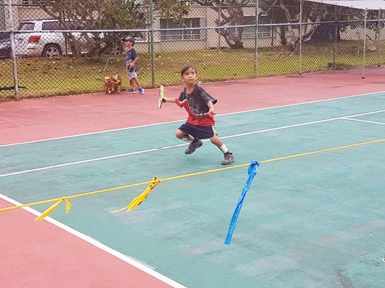In this file photo, Samuel San Agustin, 6, keeps his eye on the ball as he prepares to hit a forehand during the 2018 Calvo SelectCare Grand Prix Tournament at the Sheraton Laguna Resort and Spa.