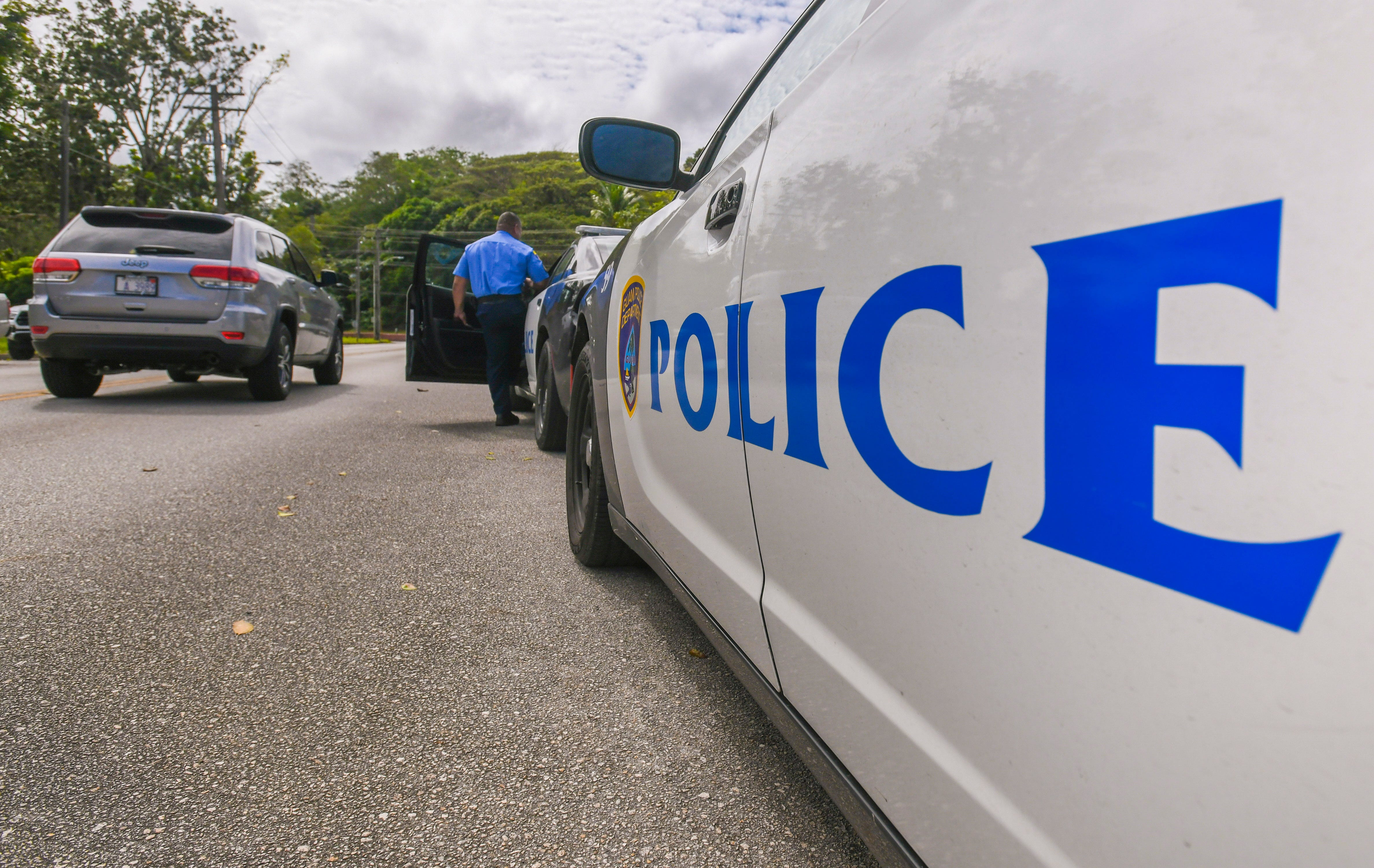 A Guam Police Department officer enters a police cruiser in preparations to depart the Hagåtña Precinct Command on Thursday, Jan. 24, 2019.