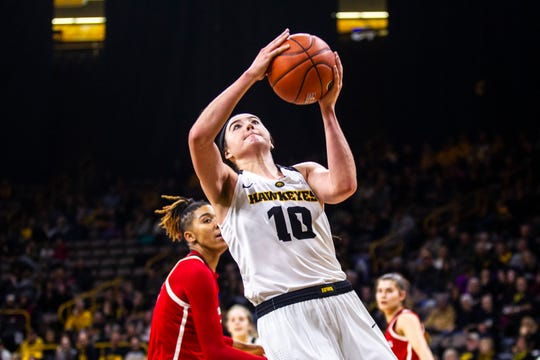 Iowa forward Megan Gustafson (10) makes a basket during a NCAA Big Ten Conference women's basketball game on Wednesday, Jan. 23, 2019, at Carver-Hawkeye Arena in Iowa City, Iowa.