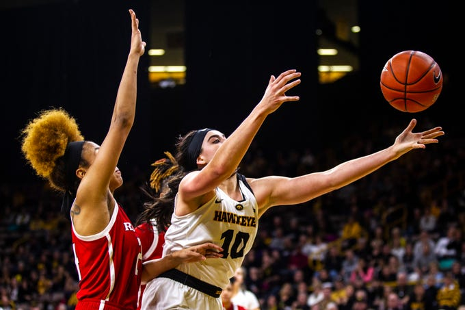 Iowa forward Megan Gustafson (10) dives for a loose ball during a NCAA Big Ten Conference women's basketball game on Wednesday, Jan. 23, 2019, at Carver-Hawkeye Arena in Iowa City, Iowa.
