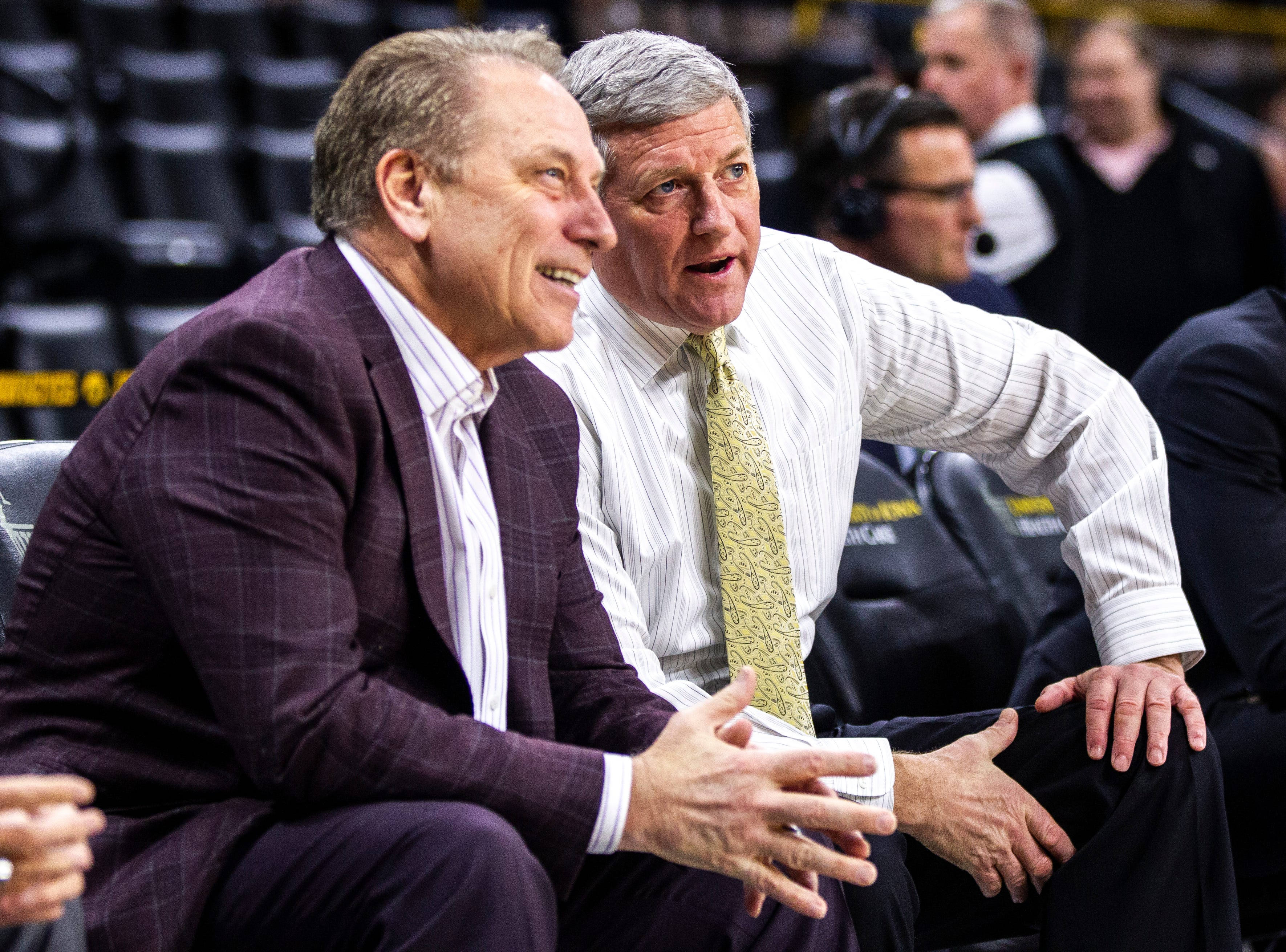 Iowa assistant Kirk Speraw, right, talks with Michigan State head coach Tom Izzo before a NCAA Big Ten Conference men's basketball game on Thursday, Jan. 24, 2019, at Carver-Hawkeye Arena in Iowa City, Iowa.