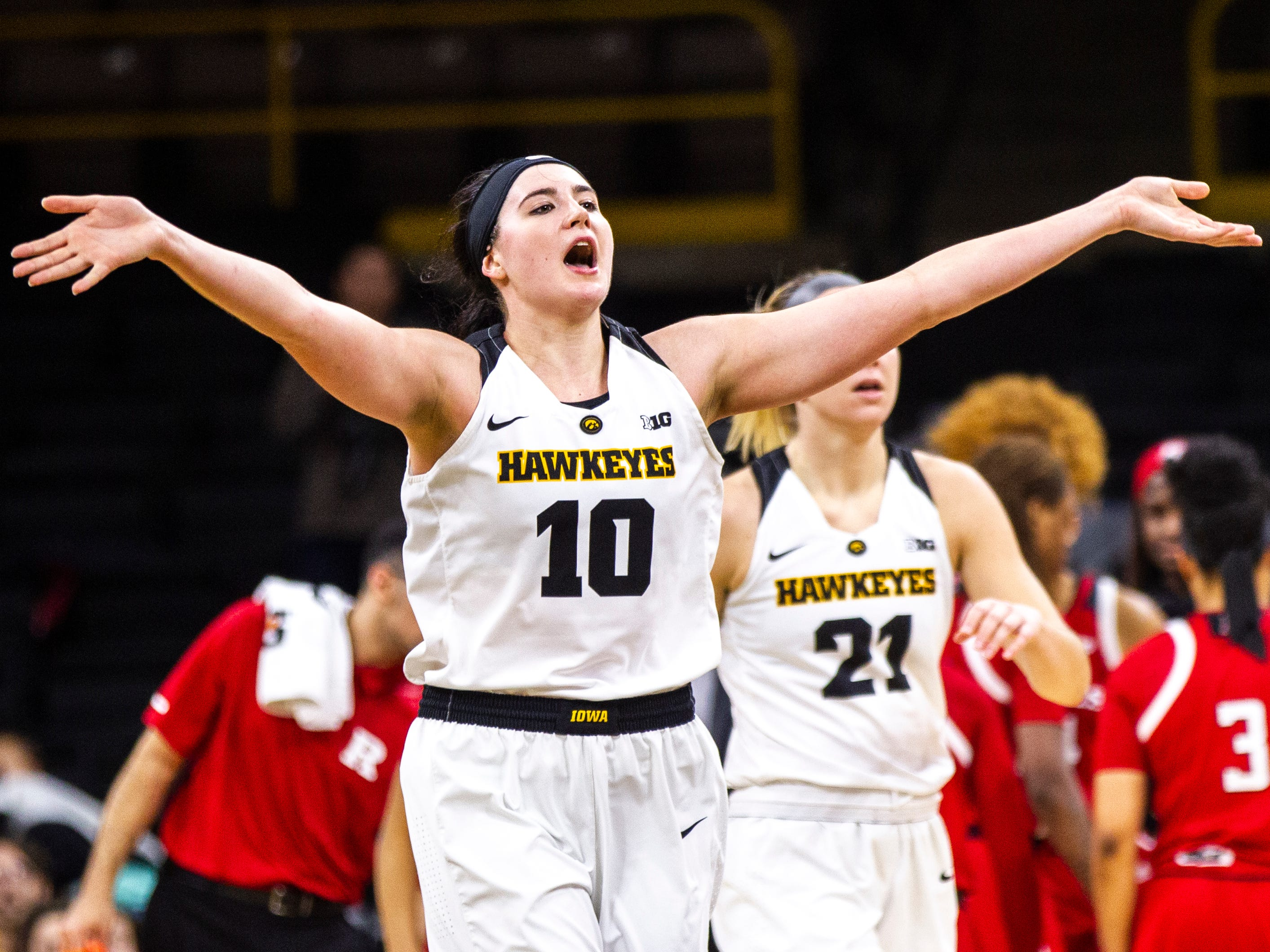 Iowa forward Megan Gustafson (10) pumps up the crowd heading into a timeout during a NCAA Big Ten Conference women's basketball game on Wednesday, Jan. 23, 2019, at Carver-Hawkeye Arena in Iowa City, Iowa.