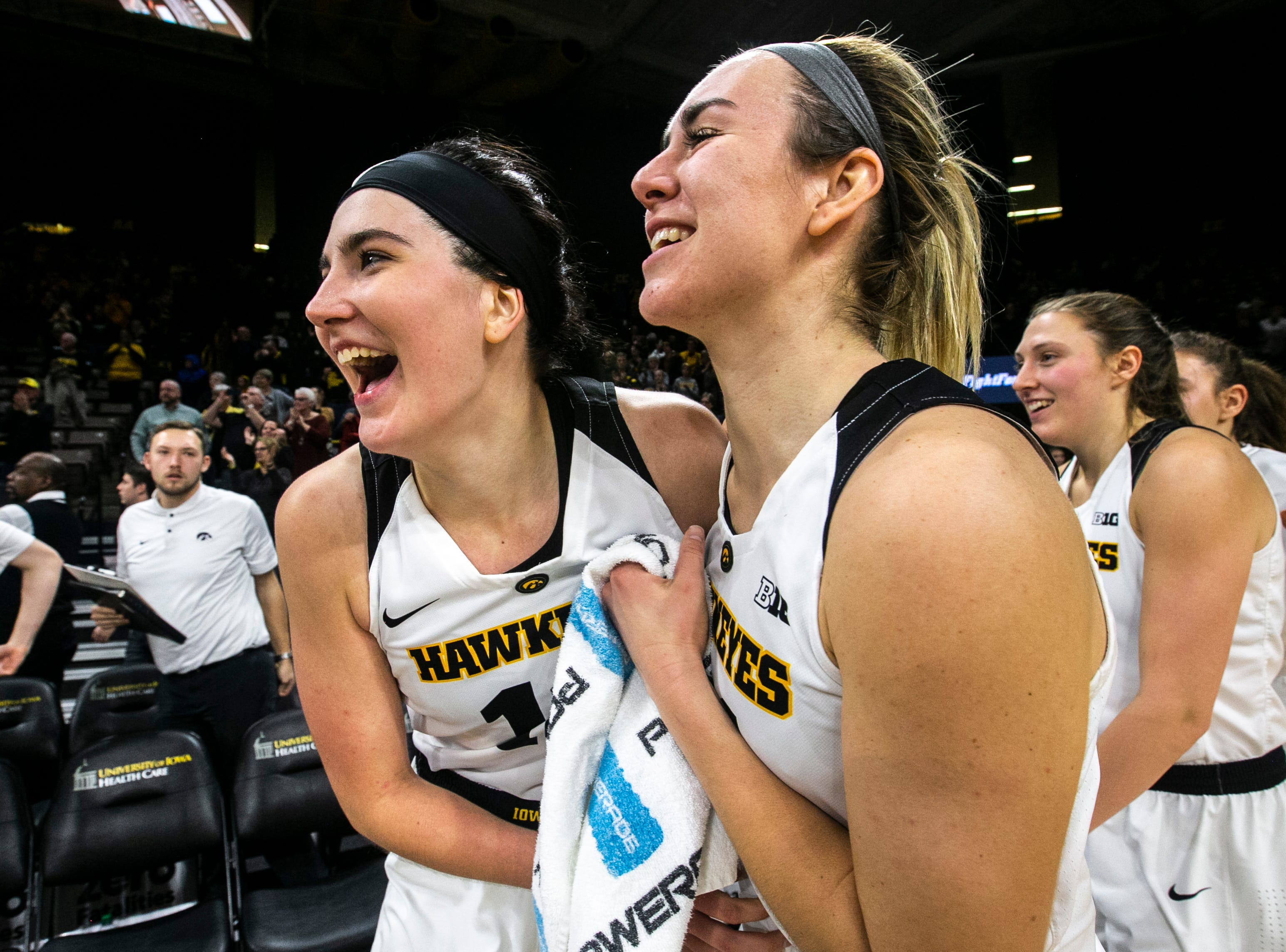 Iowa forward Megan Gustafson, left, embraces Iowa forward Hannah Stewart after a NCAA Big Ten Conference women's basketball game on Wednesday, Jan. 23, 2019, at Carver-Hawkeye Arena in Iowa City, Iowa. The Hawkeyes defeated Rutgers' Scarlet Knights, 72-66.