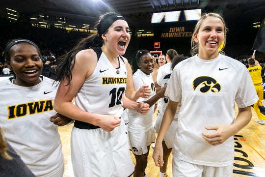 Iowa forward Megan Gustafson (10) celebrates with teammates on Jan. 23, 2019.