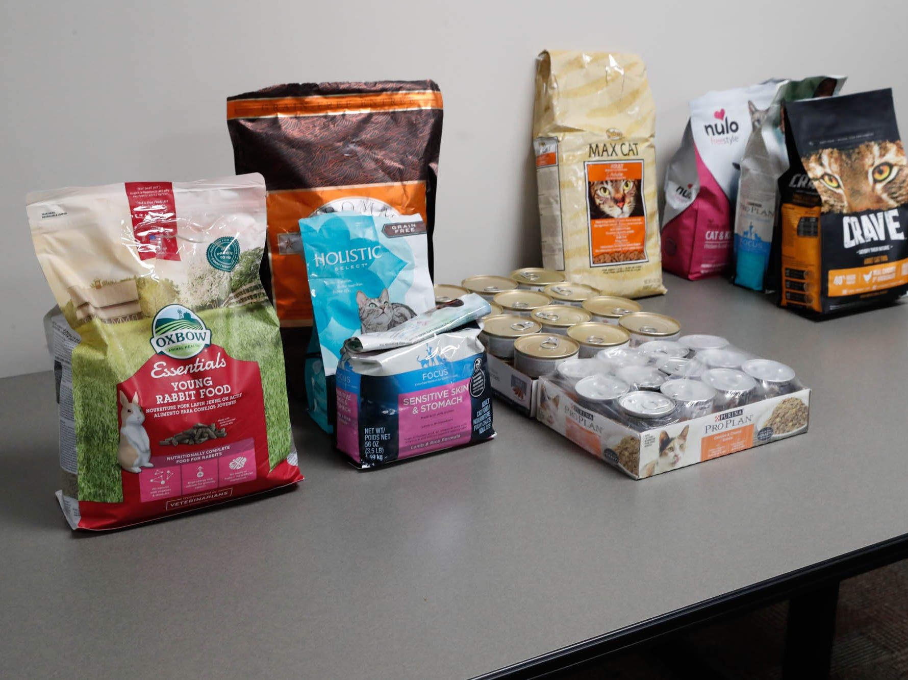 Pet food is laid out at a pop-up food pantry run by volunteers from the Old Bethel UMC for TSA  employees affected by the government shutdown at the Transportation Security Administration offices, 8303 W Southern Ave., Indianapolis, on Thursday, Jan. 24, 2019.