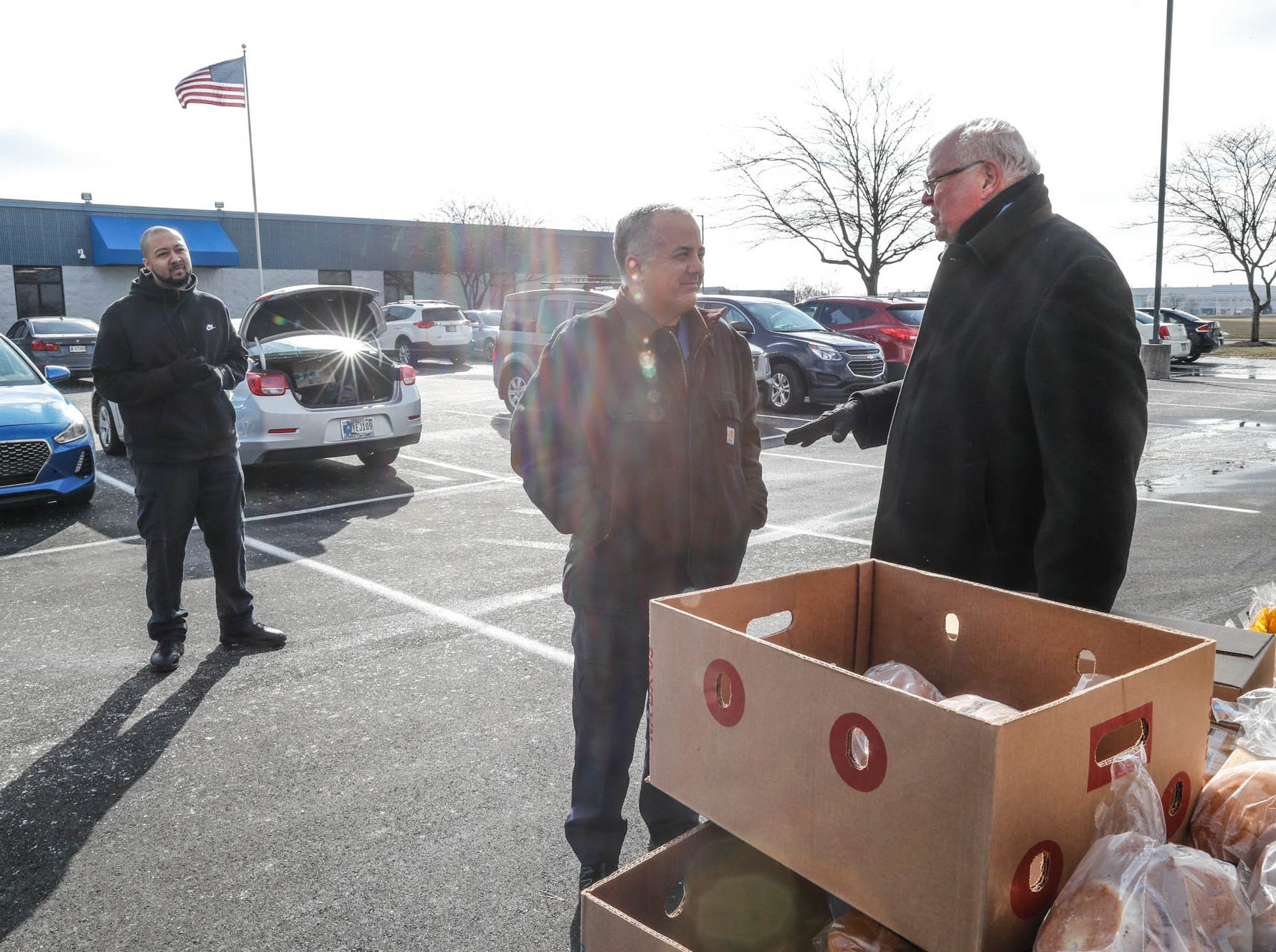 Transportation Security Officers affected by the government shutdown, John Lair, left, and Ralph Torres, center, pick up Gleaners Food Bank boxes from  Old Bethel UMC member and community volunteer Ron Phillips, right, at the Transportation Security Administration offices, 8303 W Southern Ave., Indianapolis, on Thursday, Jan. 24, 2019.