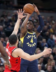 Indiana Pacers guard Victor Oladipo (4) shoots a threepointer over Toronto Raptors guard Fred VanVleet (23) in the first half of their game at Bankers Life Fieldhouse Saturday, Jan. 23, 2019.