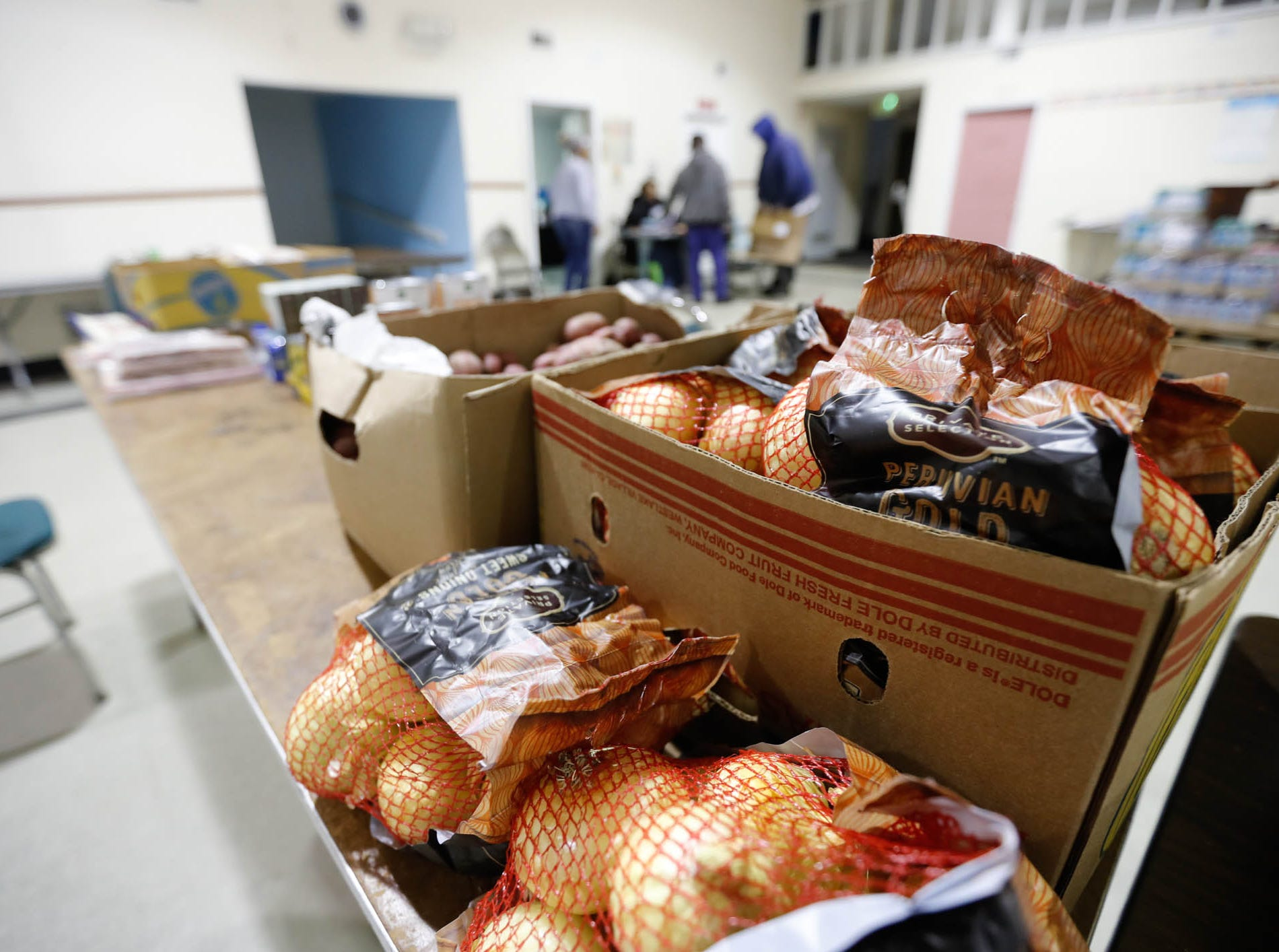 Food is ready to give away at Breeding Tabernacle Church which has started a new food pantry with later hours for federal employees who are affected by the government shutdown, Thursday, Jan. 23, 2019. The new pantry will be open on Wednesdays, 5pm-7pm, at the Breeding Tabernacle Church, 3670 North Leland, Indianapolis Ind., until the government shutdown ends.