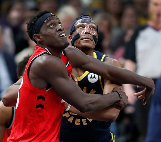 Indiana Pacers center Myles Turner (33) and Toronto Raptors forward Pascal Siakam (43) battle for position under the basket in the second half of their game at Bankers Life Fieldhouse Saturday, Jan. 23, 2019.