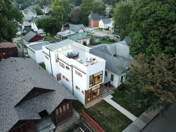 A newly built modern architectural home is up for sale at 1134 Woodlawn Ave., Indianapolis, Ind., 46203, in the heart of the historic Fountain Square neighborhood on Wednesday, January 23, 2019. The three-story home, which features 2,030-square-feet and an open space concept tile and hardwood floors are priced at $479,900.