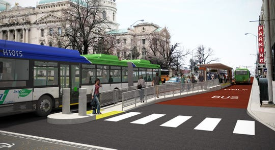 Renderings show a proposed IndyGo Red Line station on Capitol Avenue.