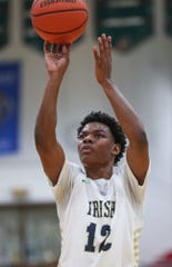 Cathedral Fighting Irish guard Tayshawn Comer (12) shoots in the second half of City tournament finals at Arsenal Technical High School in Indianapolis, Wednesday, Jan. 23, 2019. Cathedral won, 78-48.