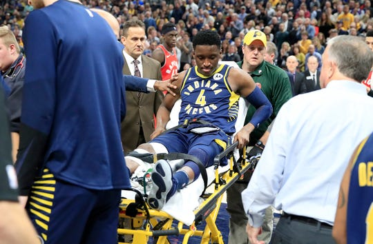 Victor Oladipo #4  of the Indiana Pacers is taken off of the court on a stretcher after being injured in the second quarter of the game against the Toronto Raptors  at Bankers Life Fieldhouse on January 23, 2019 in Indianapolis.