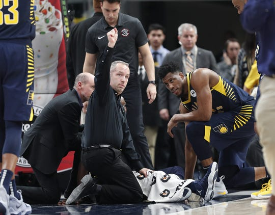 The Indiana Pacers medical staff tends to guard Victor Oladipo after he went down with a knee injury  in the first half of their game at Bankers Life Fieldhouse Saturday, Jan. 23, 2019.