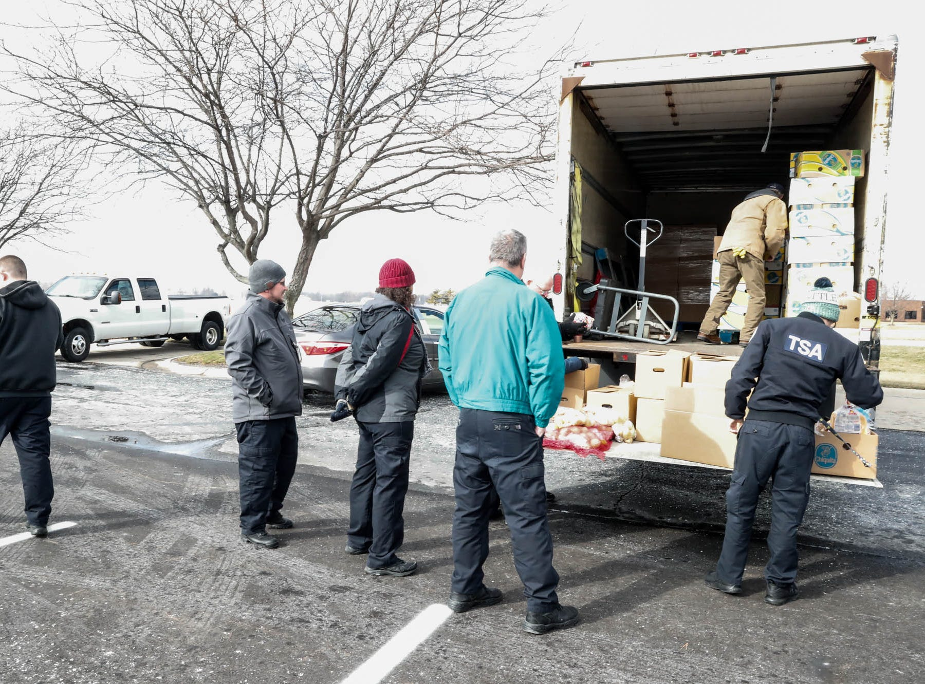 Community volunteers from Old Bethel UMC hand out Gleaners Food Bank boxes to TSA  employees affected by the government shutdown at the Transportation Security Administration offices, 8303 W Southern Ave., Indianapolis, on Thursday, Jan. 24, 2019.