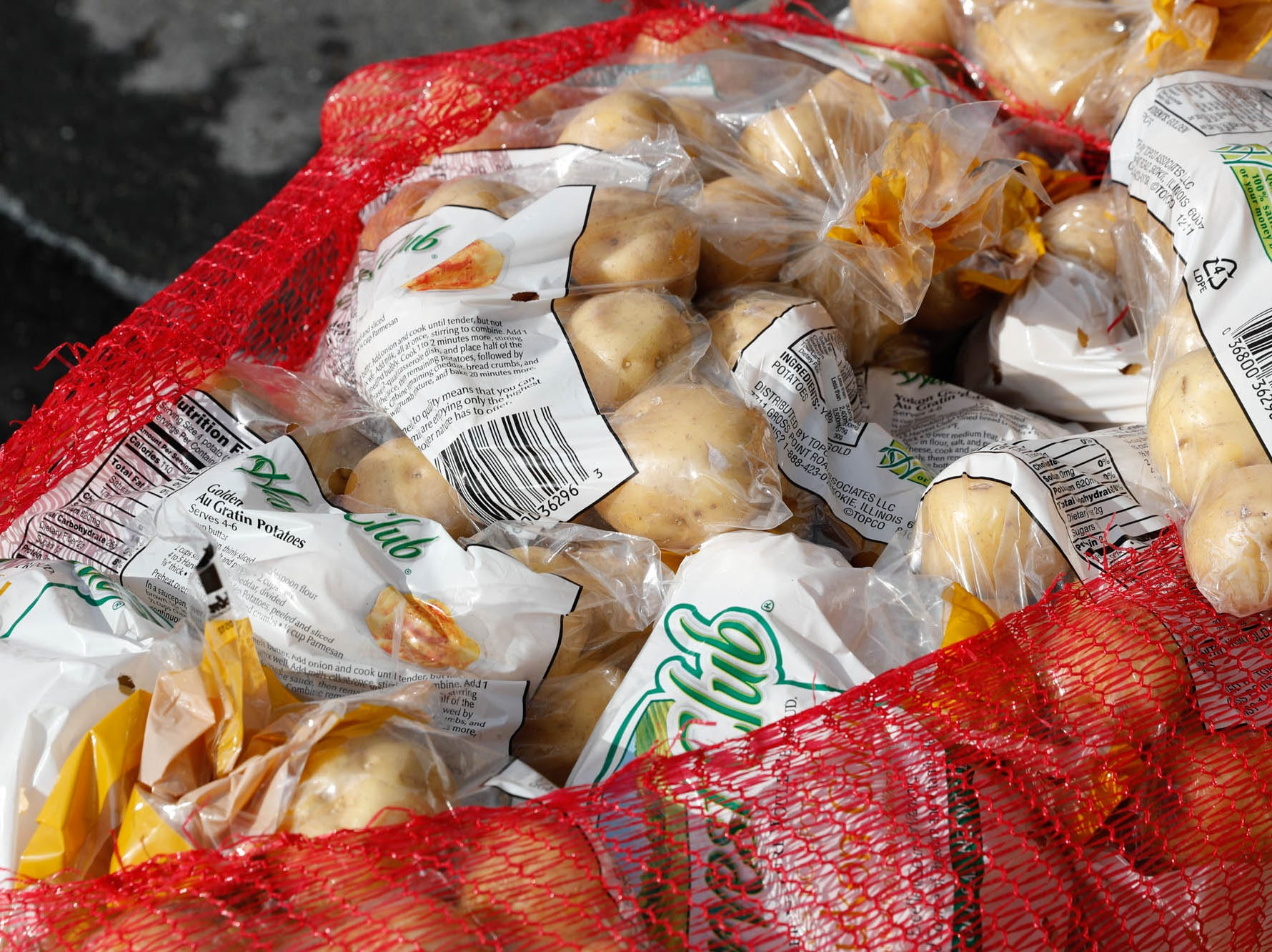 Bags of potatoes are laid out along with Gleaners Food Bank boxes to be given by volunteers from Old Bethel UMC, to TSA  employees affected by the government shutdown, at the Transportation Security Administration offices, 8303 W Southern Ave., Indianapolis, on Thursday, Jan. 24, 2019.