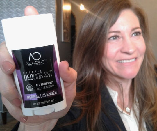 North Liberty newcomer Jane Merten displays one of her four fragrances of organic deodorant under her All Out Naturals label, just launched in September.