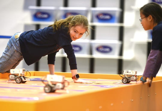 Julia Madrid, 10, of Ithaca, and Clare Pole, 10, of Ithaca, during a recent UCode class. Located at The Shops at Ithaca Mall, UCode teaches coding and computational thinking using robots.