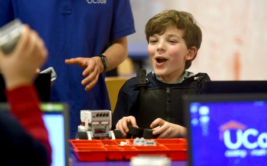 Theo Cuscher, 8, of Ithaca, during a recent class at UCode. Located in The Shops at Ithaca Mall, UCode teaches coding and computational thinking using robots.