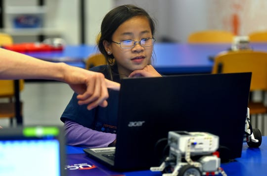 Clare Poles, 10, of Ithaca, during a recent class at UCode, located at The Shops at Ithaca Mall. UCode uses robots to teach children coding and computational thinking.