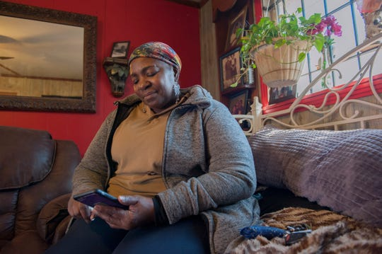 Lula Henry flips through photos on her phone looking for favorite pictures of her son Evan Henry, one of Jackson's first homicide victims of 2019. Henry, 23, was found shot to death on Jan. 1. Jackson Police suspect he was a victim of a robbery.