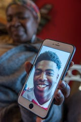 Lula Henry holds up her favorite photo of her son Evan Henry, Jackson's first homicide victim of 2019. Henry, 23, was found shot to death on Jan. 1. Jackson Police suspect he was a victim of a robbery.