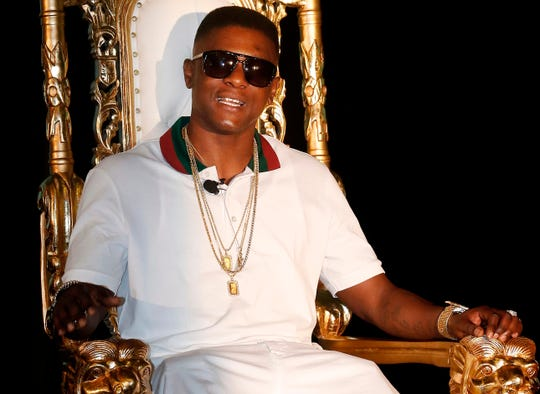 FILE - In this March 10, 2014, file photo, rapper Lil' Boosie appears at a news conference in New Orleans. Boosie, who now goes by the name Boosie BadAzz,  has settled part of his lawsuit over being pepper sprayed in a Mississippi Gulf Coast mall in April 2017.