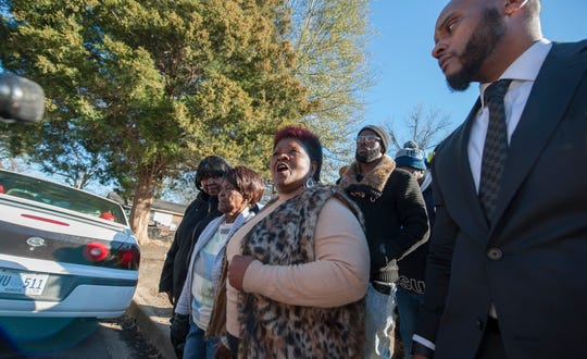 """We want Justice for George,"" says Bettersten Wade, center, during a news conference in front of George Robinson's home in the Washington Addition on Thursday, Jan. 24. Wade, Robinson's sister stands next to their mother Vernice Robinson, left of center. Robinson's family, represented by Sweet & Associates, has hired an independent investigator to look into his death. Arrested on a misdemeanor charge and then released, Robinson later died. The death has been ruled a homicide."