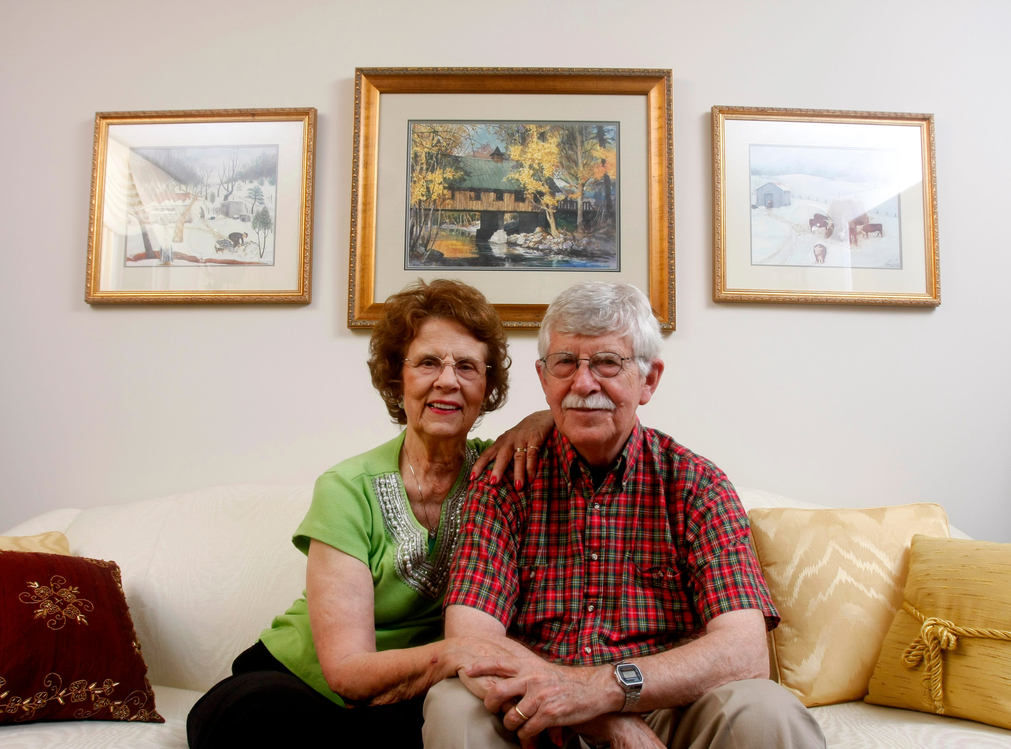 Patsy and Charlie Daniel sit together on the couch in their living room. Charlie and his wife moved to Knoxville 50 years ago for Charlie to take a job as a cartoonist for The Knoxville Journal.  The couple have been married for 54 years. Thursday ,July 3, 2008