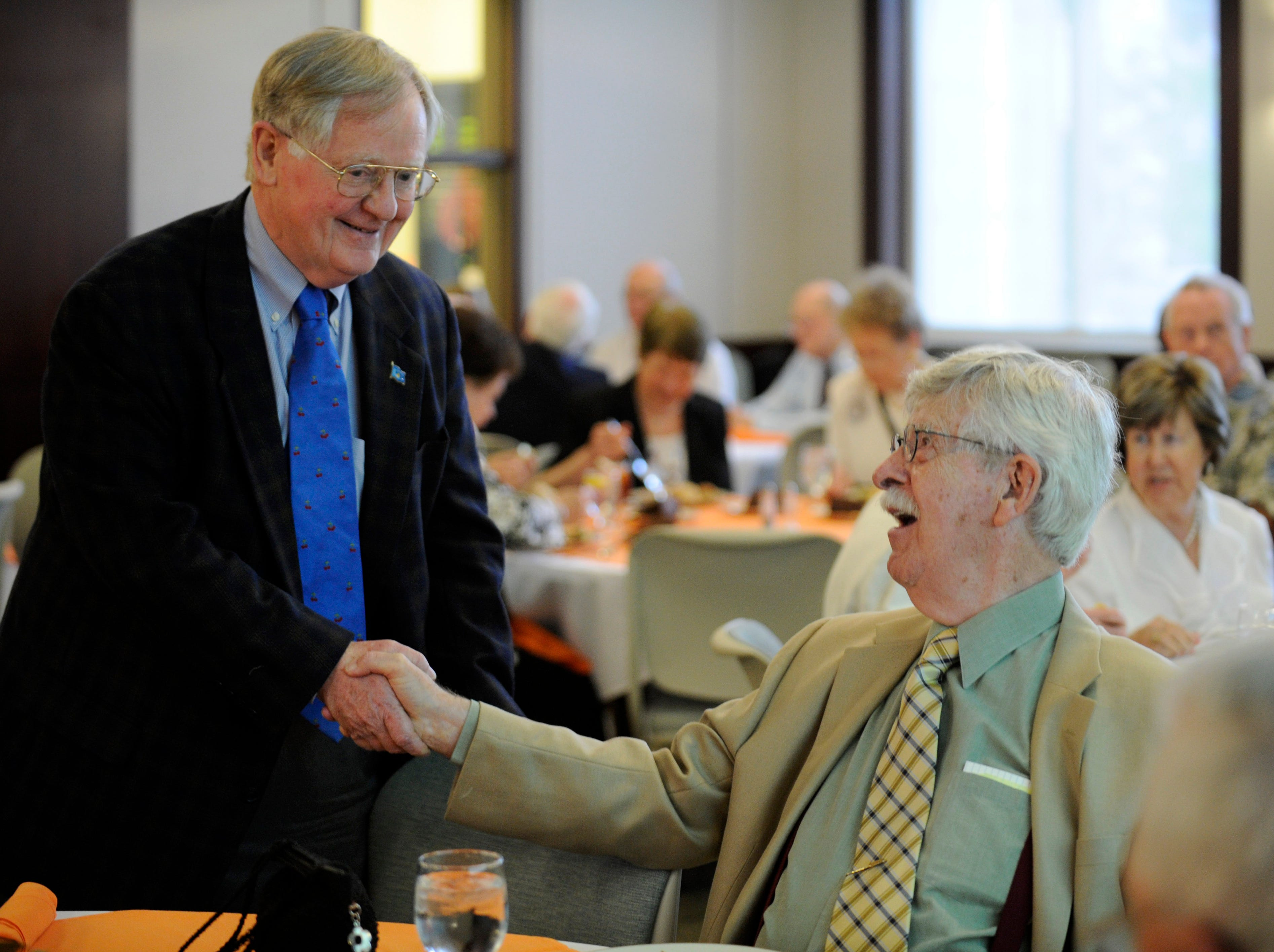 Former Ambassador to Poland and former Knoxville Mayor Victor Ashe congratulates Charlie Daniel as as former Senators Howard Baker and Nancy Kassebaum celebrate the work of the Knoxville News Sentinel cartoonist at the Baker Center on Thursday, May 17, 2012.