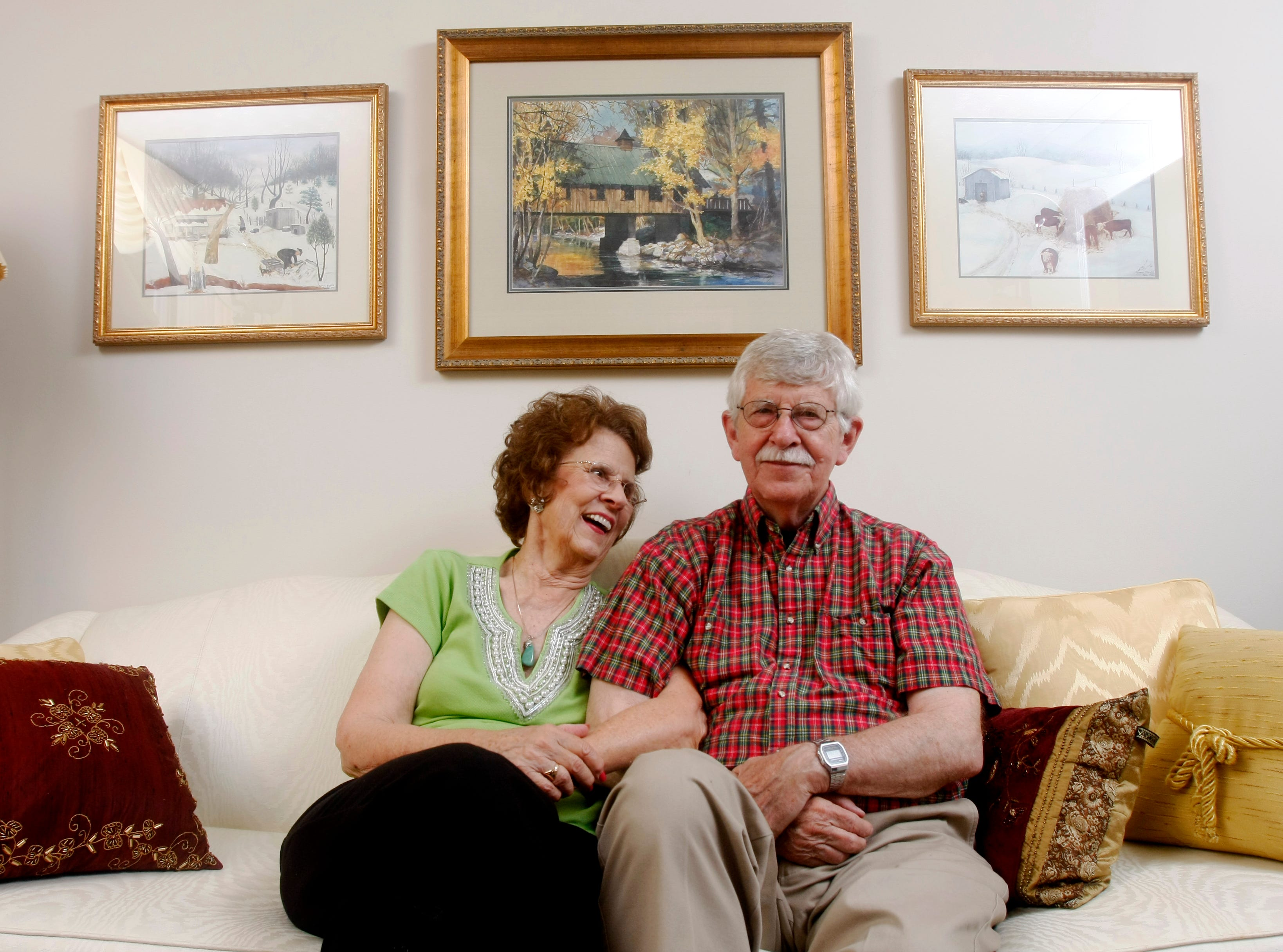 Patsy and Charlie Daniel sit together on the couch in their living room. Charlie and his wife moved to Knoxville 50 years ago for Charlie to take a job as a cartoonist for The Knoxville Journal.  The couple have been married for 54 years. Thursday, July 3, 2008