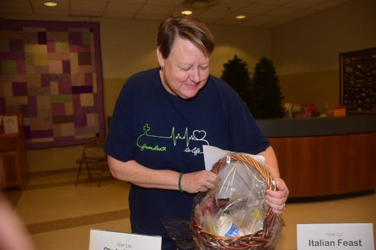 Sylvia Creswell checks out a gift basket up for auction at the chili cookoff.