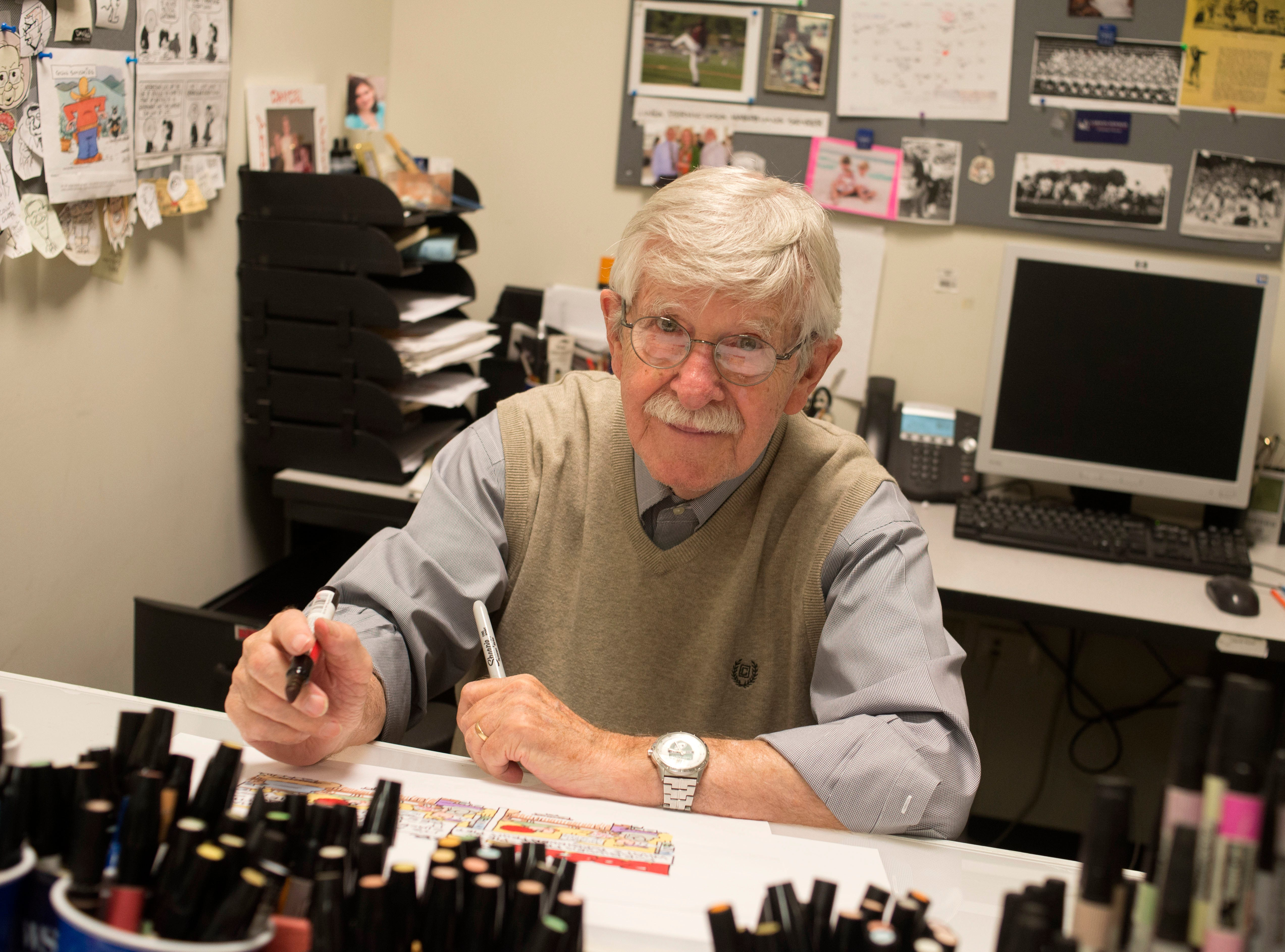 Cartoonist Charlie Daniel is pictured at work Oct. 21 2015, at the News Sentinel. Daniel will bring his pen and take in several Knoxville Symphony Orchestra Young People's Concerts this week.