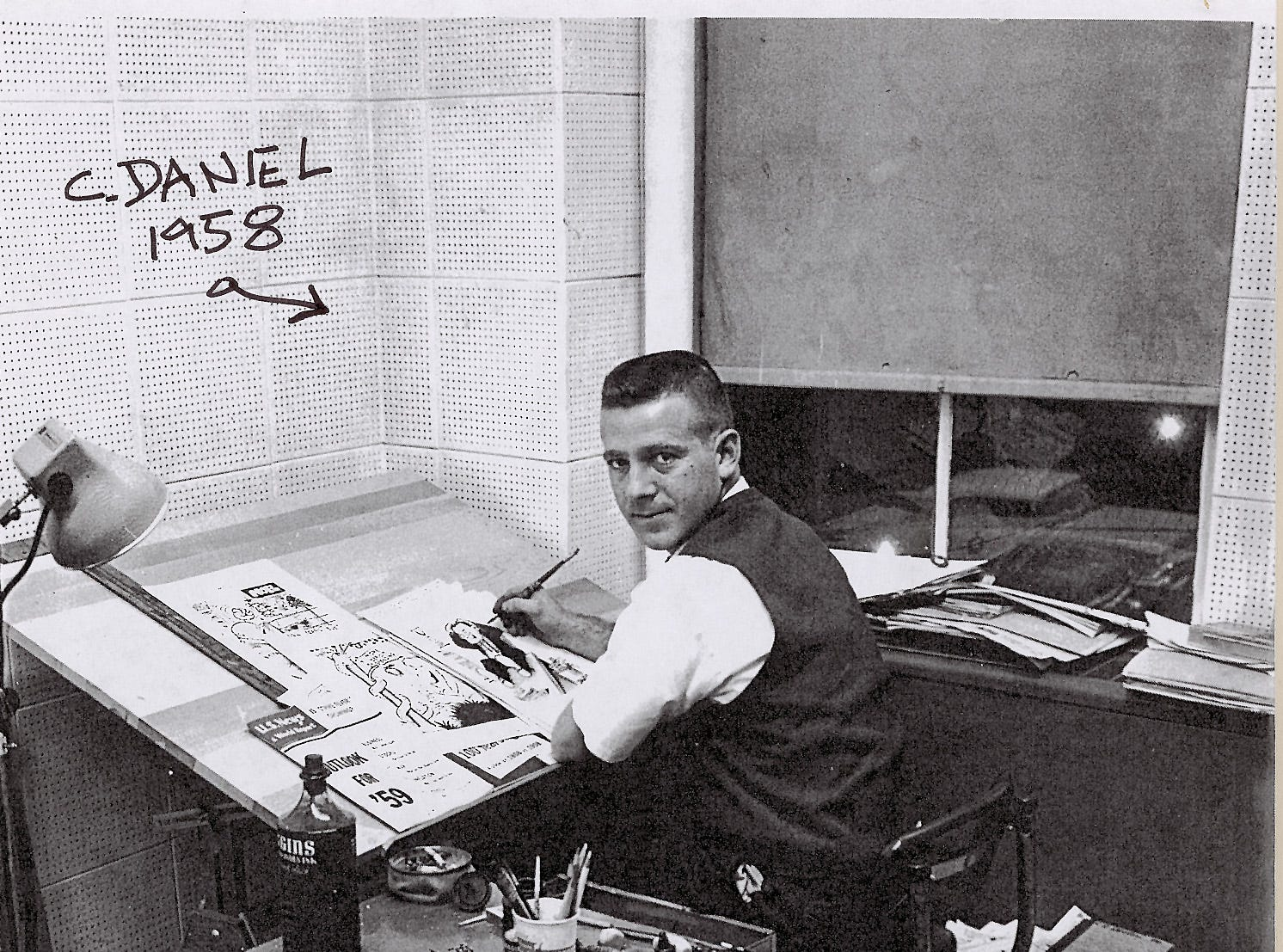 A freshly-minted editorial cartoonist Charlie Daniel plies his trade in this 1958 photograph, presumably from the newsroom of the Knoxville Journal. Daniel celebrates his 50th anniversary in 2008.