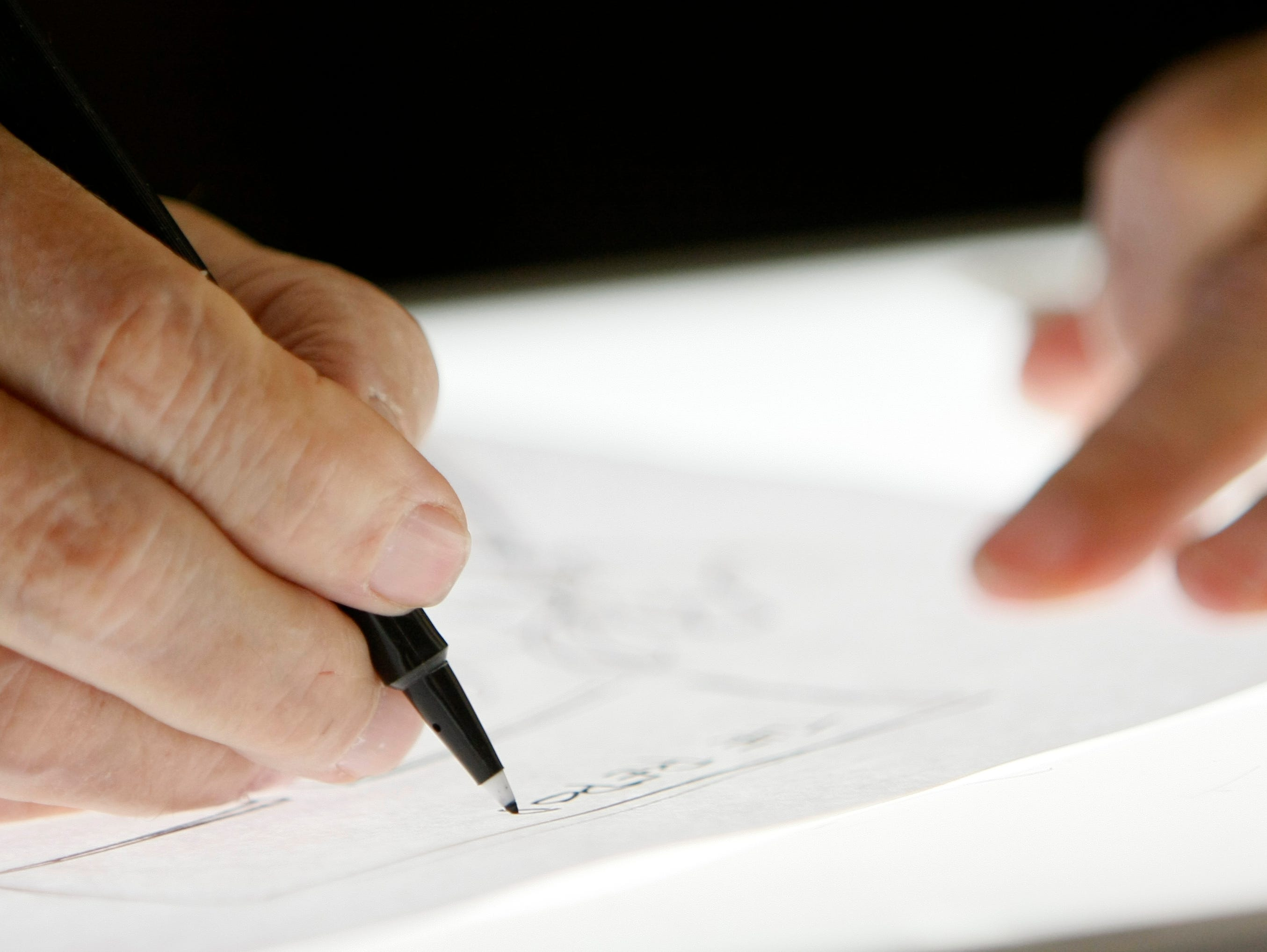 Charlie Daniel, Editorial Cartoonist for the News Sentinel, works on a drawing at his desk. Daniel is celebrating 50 years of cartooning in Knoxville staring with his first job at The Knoxville Journal. Tuesday, July 1, 2008