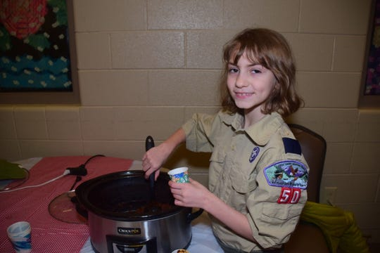 Cub Scout Jadzia Garner serves up chili at the cookoff, a new fundraiser for Beaver Ridge United Methodist Church, on Saturday, Jan. 19.