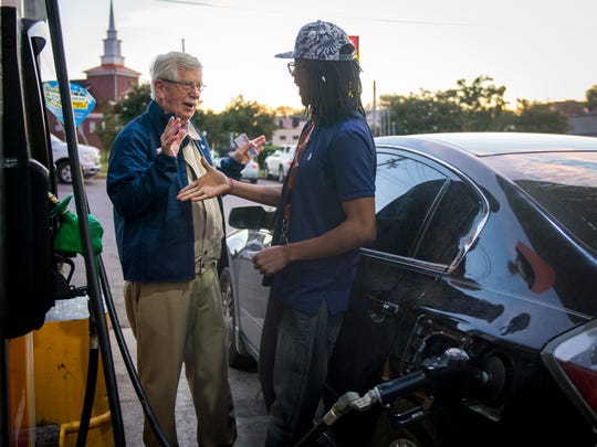 """You do the cartoons in the paper!"" exclaims Trey Blevins, right, as Knoxville News Sentinel editorial cartoonist Charlie Daniel introduces himself and hands out free drink coupons and pumps gas at the Pilot gas station on Western Avenue on Oct. 2, 2017. Daniel was part of Pilot Celebrity Pumpers, in which Knoxville celebrities help pump gas in support of Pilot's fundraising efforts for the United Way."