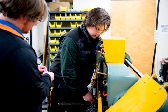 Mechanical engineering student Daniel Rasmussen works on creating locating rods for a welding jig Jan. 23, 2019. Engineering students in the Pellissippi State Motorsports Club are building and designing a car to race at Formula SAE in Michigan this spring.