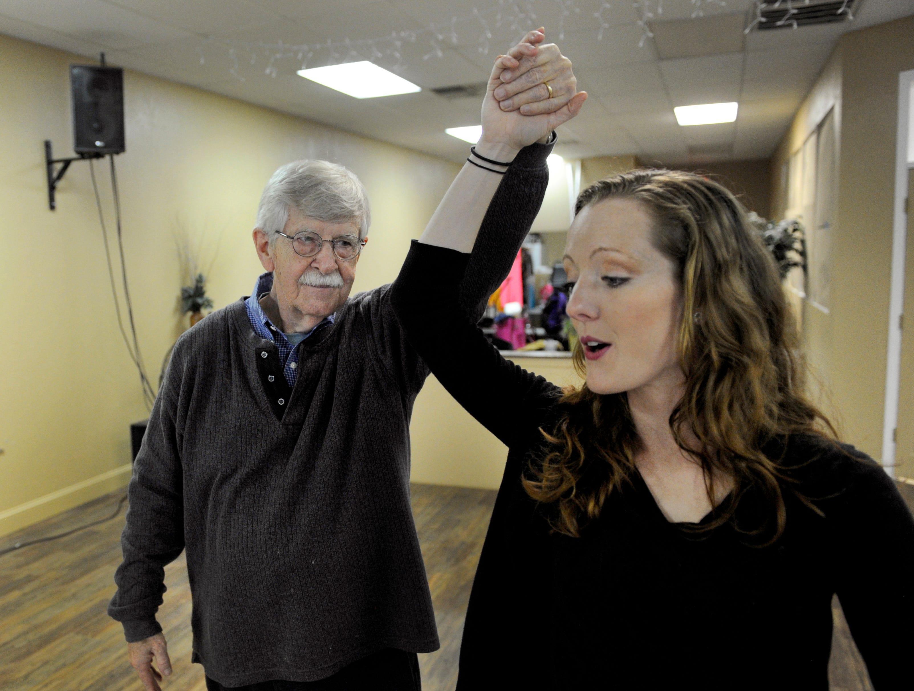 Charlie Daniel spins his dance partner Stephanie Braeuner (CQ) during practice Tuesday, Mar. 12, 2013 at Academy Ballroom. Charlie Daniel is representing the News Sentinel in the annual Children's Hospital fundraiser dancing w/ the knoxville stars.