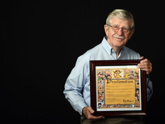 Charlie Daniel holds a proclamation from the National Cartoonists Society recognizes his long career. Daniel will retire from the News Sentinel on Feb. 1 after more than 60 years of cartooning.