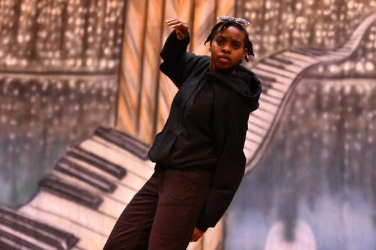 "Maria Holt performs a solo piece to ""Black"" by rapper Simmie Sims III during the Black History Month celebration at Holston Middle School. Holt is a student at Austin-East Magnet High School."