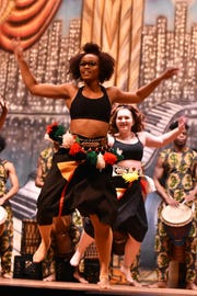 Camiah Wilson, front, and Jackie Walker perform a West African dance for Holston Middle School students on Wednesday, Jan. 23.