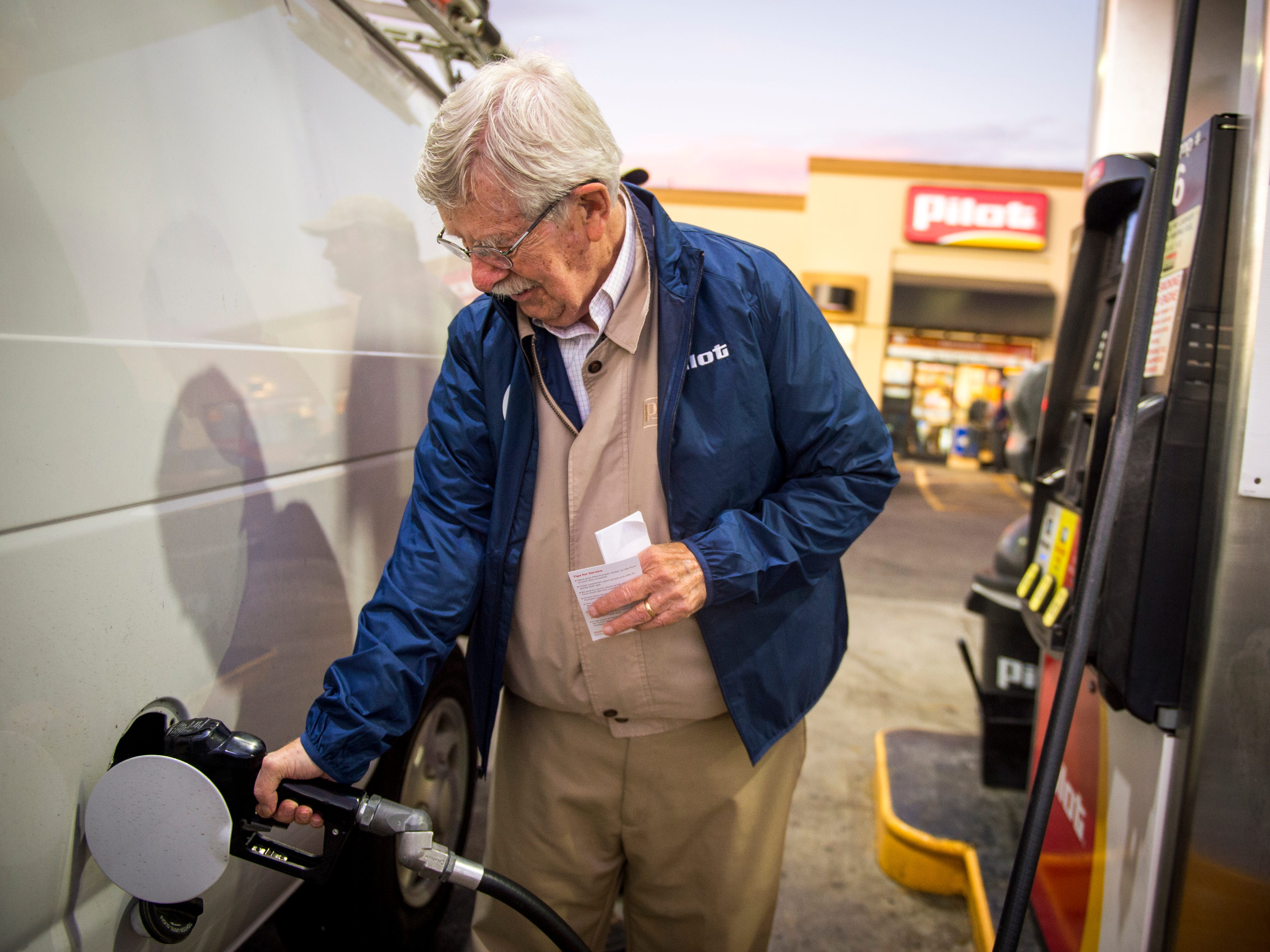 Knoxville News Sentinel editorial cartoonist Charlie Daniel helps pump gas at the Pilot gas station on Western Ave. on Monday, Oct. 2, 2017. Daniel is part of Pilot Celebrity Pumpers, where Knoxville celebrities help pump gas in support of Pilot's fundraising efforts for the United Way.
