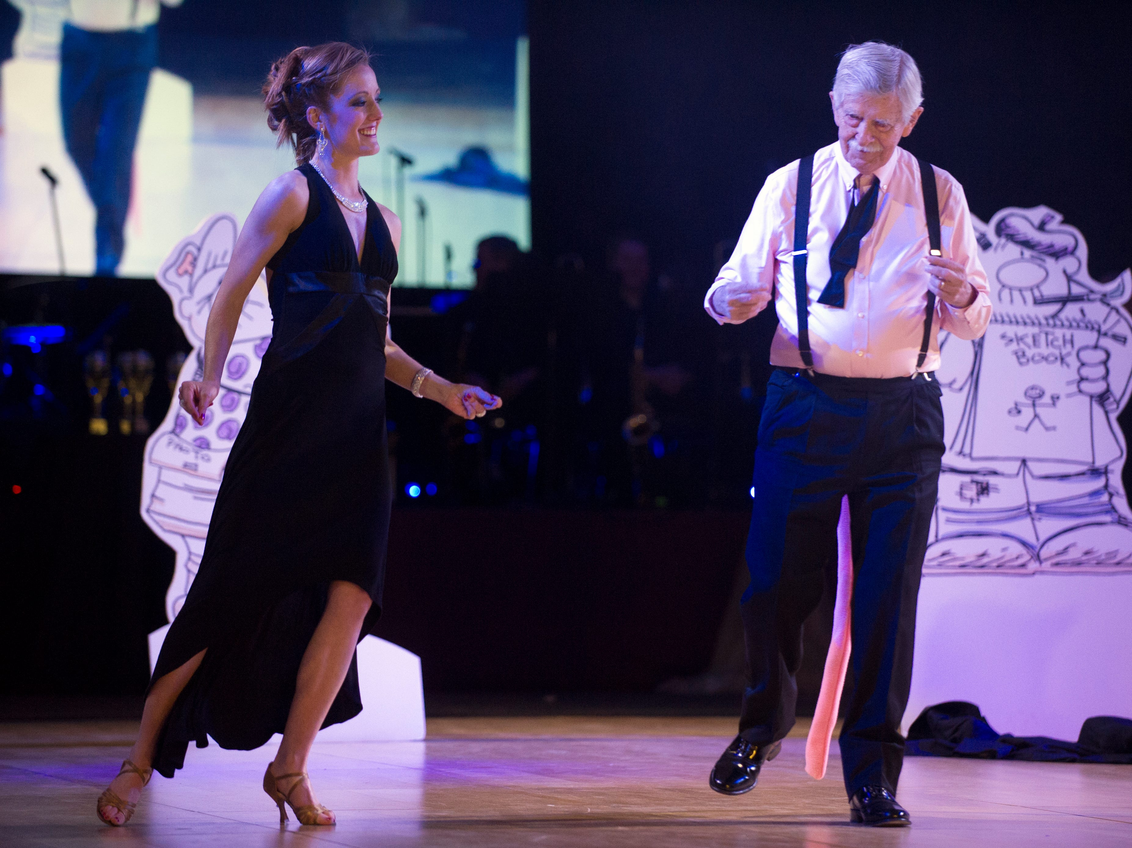 Knoxville News Sentinel cartoonist Charlie Daniel, right, dances with Stephanie Braeuner during Dancing with the Knoxville Stars at the Knoxville Expo Center Friday, March 22, 2013.
