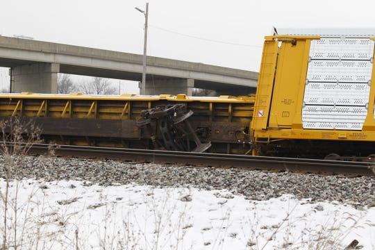 Several train cars typically used for transporting automobiles derailed Thursday near Veterans Memorial Parkway south of Indiana 38.