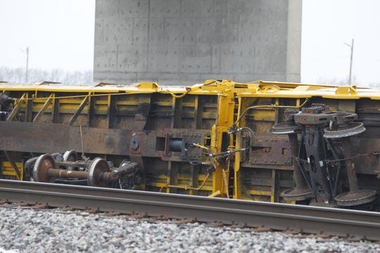 Several train cars typically used to transport automobiles derailed Thursday near Veterans Memorial Parkway south of Indiana 38.
